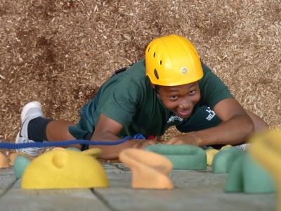 Boy climbing wall at Lake Delaware Boys' Camp.