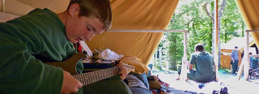 boy-playing-guitar-lake-delaware-boys-camp