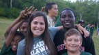 Camp counselor with happy LDBC campers