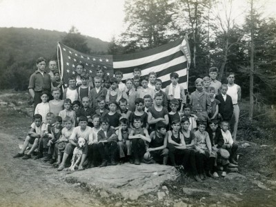 ldbc campers with large American flag.