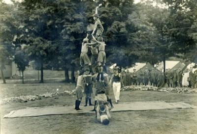LDBC Boys' making an acrobatic pyramid.