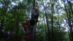 Riding the zip line at Lake Delaware Boys' Camp.