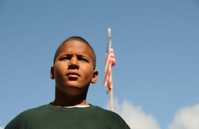 Young Lake Delaware camper with flag.